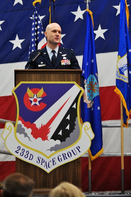 Air National Guard Col. Gregory T. White, 233d Space Group Commander, addresses the newly appointed group after assuming command during the 233d Space Group Activation Ceremony, March 10, 2013, Greeley Air National Guard Station, Greeley, Colo. The 137th Space Warning Squadron reorganized as the 233d Space Group and will continue to operate under the 140th Wing, performing the one-of-a-kind Mobile Ground System mission that these men and women have been doing since 1996. (Air National Guard photo by Tech. Sgt. Wolfram M. Stumpf)
