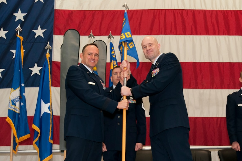 Air National Guard Brig. Gen. Trulan Eyre, 140th Wing Commander, hands the 233d Space Group flag to Col. Gregory T. White, the newly appointed 233d Space Group Commander, during the 233d Space Group Activation Ceremony, March 10, 2013, Greeley Air National Guard Station, Greeley, Colo.  The 137th Space Warning Squadron reorganized as the 233d Space Group and will continue to operate under the 140th Wing, performing the one-of-a-kind Mobile Ground System mission that these men and women have been doing since 1996.  (Air National Guard photo by Tech. Sgt. Wolfram M. Stumpf)