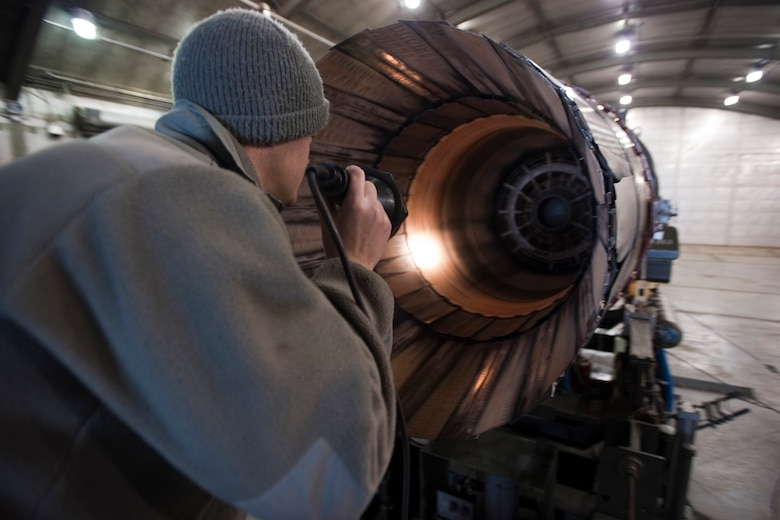 U.S. Air Force Senior Airman Shawn Hanson, a mechanic with the 169th Maintenance Squadron propulsion unit, inspects the inside of the a Pratt Whitney 229, block 52 jet engine after it was tested inside the hush house at McEntire Joint National Guard Base, S.C., March 2, 2013. Hanson ensures there are no leaks or damage before and after the engine is ran in the hush house. (National Guard photo by Staff Sgt. Jorge Intriago/Released)