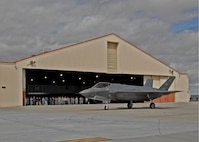 Members of the 461st Flight Test Squadron and Joint Strike Fighter Integrated Test Force watch the arrival of one of two F-35As to begin operational testing March 6. Team members from Air Combat Command's 31st Test and Evaluation Squadron, a tenant unit here, will determine how to best tactically operate the F-35A conventional takeoff and landing variant of the fifth-generation fighter. (U.S. Air Force photo by Laura Mowry)