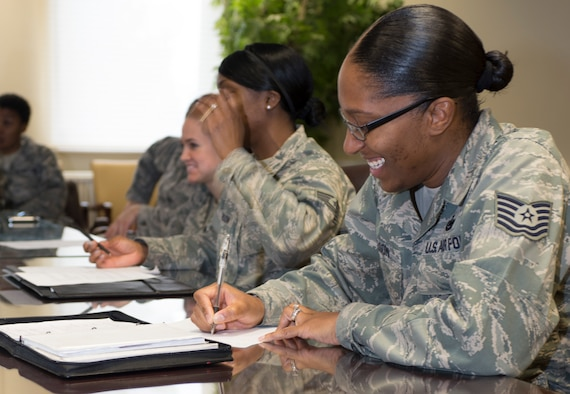 SPANGDAHLEM AIR BASE, Germany -- Tech. Sgt. Victoria Wilson, Pitsenbarger Airman Leadership School instructor from Detroit, takes notes at a SpangDamen women's success forum brain-storming meeting March 7, 2013 at the Spangdahlem conference room. The women's is an outreach program designed by military women for military women of all ranks. Meetings are held the third 11:30 a.m.-1230 p.m. the Thursday of each month at the Spangdahlem conference room behind Kuhl Beans. (U.S. Air Force photo by Senior Airman Natasha Stannard/Released)