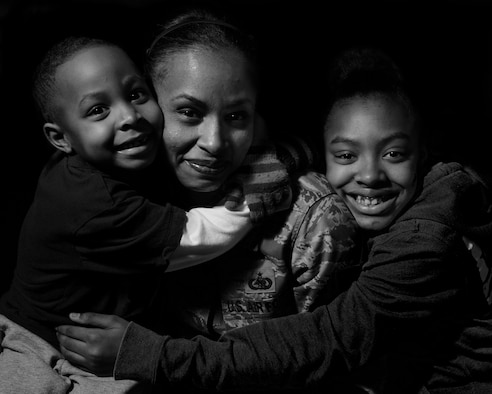 ROYAL AIR FORCE LAKENHEATH, England - Tech. Sgt. Tanya Evans, 48th Logistics Readiness Squadron Traffic Management Office receiving and inbound NCO in charge, and her two kids Marquis and Tierra pose for a photo March 11, 2013.  Evans story of overcoming domestic abuse is one of several being featured during Womens' History Month. (U.S. Air Force photo by Staff Sgt. Stephanie Mancha)