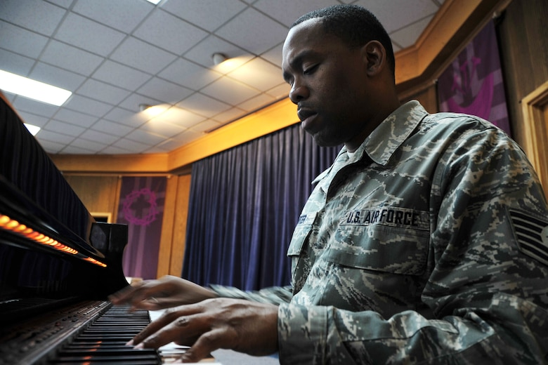 Tech. Sgt. Robert Carter, 7th Air Force knowledge operations NCO in charge, practices a song on the piano at the base chapel March 13, 2013. Since being stationed at Osan, Carter has worked with the chapel gospel choir, sung national anthems, written and produced his own music and has joined a local band called Those Guys. (U.S. Air Force photo/Senior Airman Kristina Overton)