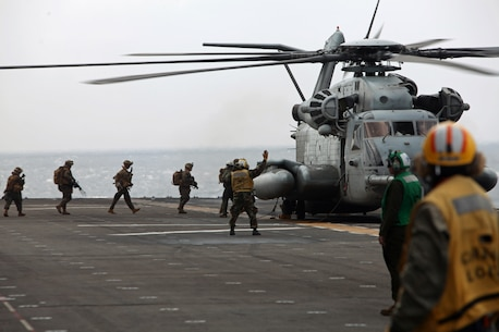 Members of the 31st Marine Expeditionary Unit's Tactical Recovery of Aircraft and Personnel team board a CH-53E Super Stallion helicopter here, March 14. The 31st MEU is currently deployed with PHIBRON 11, conducting their semi-annual Certification Exercise. CERTEX is designed to test the MEU's wide range of capabilities, ensuring their readiness for any contingency that may occur in the region. The 31st MEU is the Marine Corps' force in readiness for the Asia-Pacific region and the only continuously forward-deployed MEU.