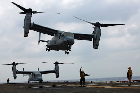 An aviation boatswain's mate (handling) with Amphibious Squadron 11 guides an MV-22 Osprey helicopter from Marine Medium Tiltrotor Squadron 265 on to the flight deck here, March 14. As one of the rotating squadrons of the 31st Marine Expeditionary Unit, VMM-265 must maintain proficiency in landing on the deck of a moving ship. The 31st MEU is currently deployed with Amphibious Squadron 11, conducting their semi-annual Certification Exercise. CERTEX is designed to test the MEU's wide range of capabilities, ensuring their readiness for any contingency that may occur in the region. The 31st MEU is the Marine Corps' force in readiness for the Asia-Pacific region and the only continuously forward-deployed MEU.