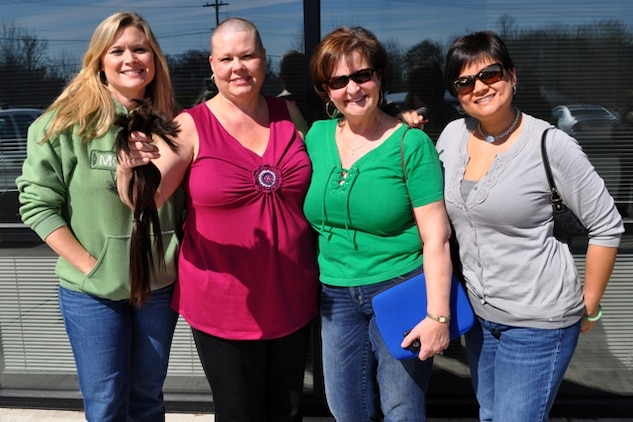 Sharon Crusenberry (second from left) joins her Marine Corps System Command and Program Executive Officer Land Systems supporters after she volunteered to have her head shaved March 10 at Paddy's Steakhouse and Pub in Stafford, Va. Crusenberry, who supports the Medium/Heavy Tactical Vehicles program under PEO LS, participated in the St. Baldrick's Foundation head-shaving event to help fight childhood cancer. Her supporters from left are Kristelle Muterspaw, Marine Air-Ground Task Force Command, Control and Communications; Shirley Shanahan, Ground-Based Air Defense and Ground/Air Task-Oriented Radar; and Marti Ramsey, Infantry Weapons Systems.