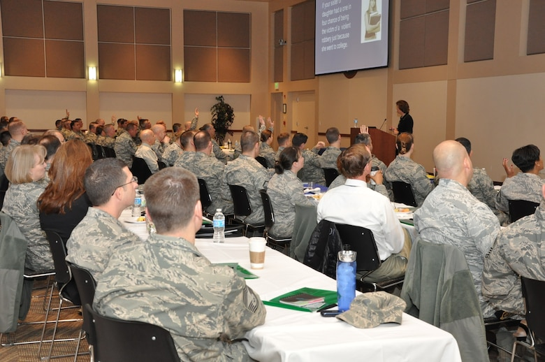 People raise their hands in response to a question from Anne Munch, a consultant and an advocate for victims of domestic violence, sexual assault and stalking, March 13, 2013, in the Leadership Development Center on Buckley Air Force Base, Colo. Munch provided insight for more than 150 service member and civilian leaders into how they can better cultivate an environment of intolerance for sexual assault. (U.S. Air Force photo by Staff Sgt. Kali L. Gradishar/Released)