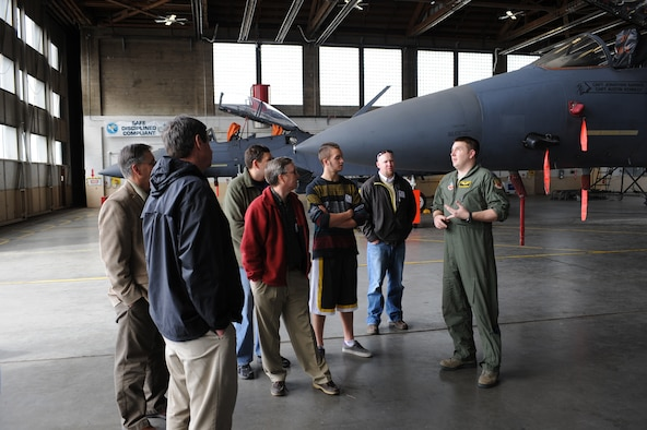 U.S. Air Force Capt. Daniel Dlugiewicz, 391st Fighter Squadron scheduler, speaks with honorary commanders March 13, 2013, at Mountain Home Air Force Base, Idaho. Aircrew members were available to talk about the flight capabilities of the F-15E Strike Eagles they fly. (U.S. Air Force photo/Senior Airman Benjamin Sutton)