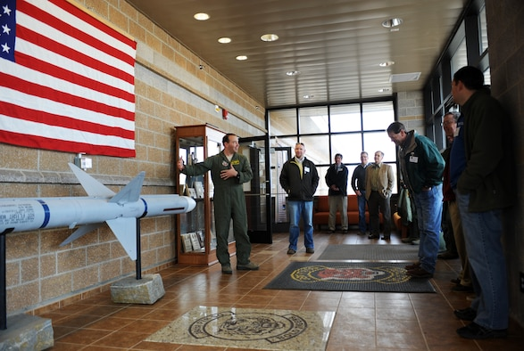 U.S. Air Force Lt. Col. David Brynteson, 391st Fighter Squadron commander, shows honorary commanders the AIM-7 Sparrow missile inside the 391st FS foyer March 13, 2013, at Mountain Home Air Force Base, Idaho. The civilian commanders were able to tour the building and meet with F-15E Strike Eagle fighter pilots. (U.S. Air Force photo/Senior Airman Benjamin Sutton)