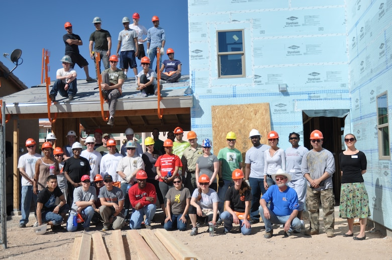 More than 45 Airmen from Davis-Monthan AFB came together to donate six hours of their off-duty time to build homes for Habitat for Humanity in Tucson, Ariz., March 14. (USAF photo by Master Sgt. Kelly Ogden/Released).