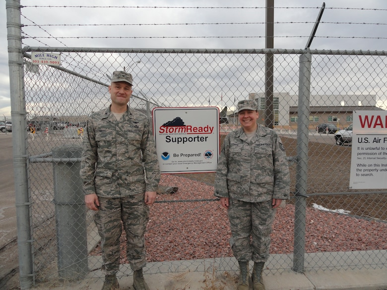 Air National Guard Col. Gregory White, commander, and Tech. Sgt. Michelle Leonard, installation emergency manager, 233d Space Group, show off the installation's new sign, recognizing it as a StormReady supporter through the National Weather Service program. (Air National Guard photo contributed by Tech Sgt. Michelle Leonard)