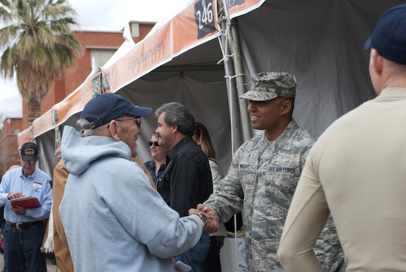 Tech. Sgt. James Wright, a recruiter with the 162nd Fighter Wing, introduces himself to a military veteran March 9 at the annual Festival of Books in Tucson, Ariz. The wing recruiting team and student flight members operated a booth at the festival to provide community service and interface with community members. (U.S. Air Force photo by Staff Sgt. Heather Davis)