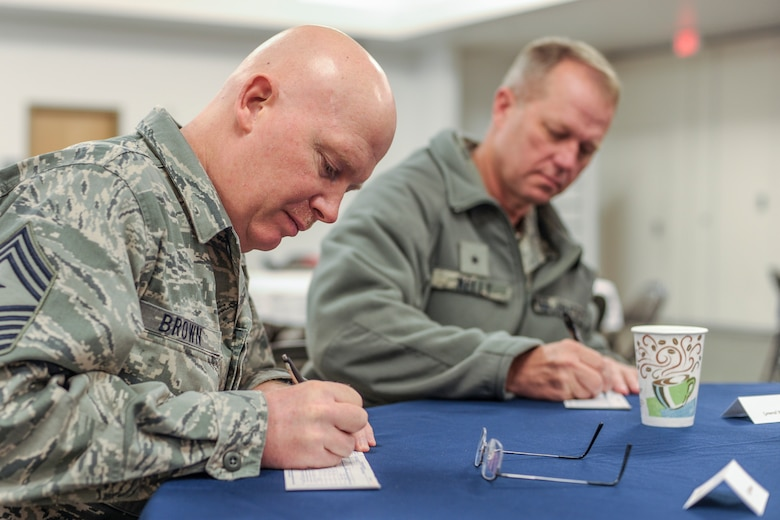 U.S. Air Force Command Chief Master Sgt. Jeffery Brown, 354th Fighter Wing command chief, and Brig. Gen. Mark Kelly, 354th FW commander, sign Air Force Assistance Fund payroll deduction forms at the AFAF fundraiser kickoff at the base chapel March 11, 2013, Eielson Air Force Base, Alaska. Donations to the campaign lend critical support to fellow Airmen and their families. For more information, contact your unit AFAF Key Worker.  (U.S. Air Force photo/Airman 1st Class Peter Reft)