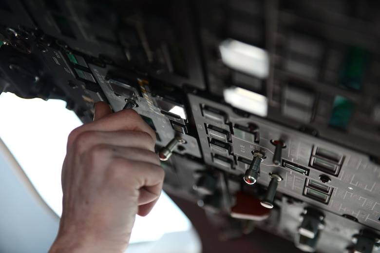 SPANGDAHLEM AIR BASE, Germany – U.S. Air Force Senior Airman Joshua Kujawa, 726th Air Mobility Squadron integrated flight control technician from Toms River, N.J., turns on the auxiliary power unit of a C-17 Globemaster III March 13, 2013. The APU is used to power parts of the aircraft when it is at rest if external power units are not available. (U.S. Air Force photo by Airman 1st Class Gustavo Castillo/Released)