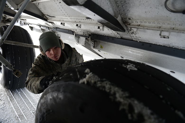 SPANGDAHLEM AIR BASE, Germany – U.S. Air Force Airman 1st Class Michael Bosch, 446th Aircraft Maintenance Squadron crew chief from Fedoa, Wash., checks the tires on a C-17 Globemaster III March 13, 2013. The 446th AMXS is assisting the 726th Air Mobility Squadron with airflow during a two-week temporary duty. (U.S. Air Force photo by Airman 1st Class Gustavo Castillo/Released)