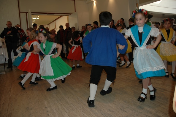 SPANGDAHLEM AIR BASE, Germany -- Children of a local folk square dance group perform a dance inside the Beda Haus cultural center during a past Beda market event. Inside the Beda market, people can also find a book flea market. (U.S. Air Force photo by Iris Reiff/Released)