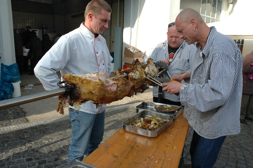 SPANGDAHLEM AIR BASE, Germany -- Butchers from Bitburg offered roasted pork meat at a Beda Market event in 2009. Besides tasting traditional food items, visitors can expect to see crafts made by local craftsmen, classic vehicles and much more. This year's event will take place March 15-17. Stores will open from 1-6 p.m. March 17, which is a Sunday. (U.S. Air Force photo by Iris Reiff/Released)