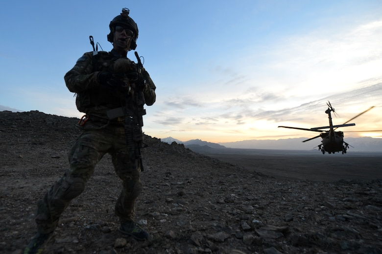 Maj. Joe Lopez, 83rd Expeditionary Rescue Squadron combat rescue officer, calls to the HH-60G Pave Hawk with a ground report outside of Bagram Airfield, Afghanistan, March 12, 2013. The 83rd ERQS Guardian Angel are comprised of three career fields: the CRO (combat rescue officer), the PJ (pararescuemen) and SERE (survival, evasion, resistance, escape).  (U.S. Air Force photo/Senior Airman Chris Willis)