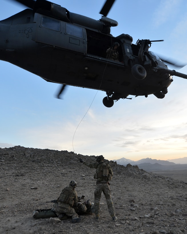 Members of the 83rd Expeditionary Rescue Squadron Guardian Angel transport a patient using an HH-60G Pave Hawk during a training mission outside of Bagram Airfield, Afghanistan, March 12, 2013. The 83rd ERQS Guardian Angel's mission is to rescue, recover and return American or allied forces in times of danger or extreme duress.  (U.S. Air Force photo/Senior Airman Chris Willis)