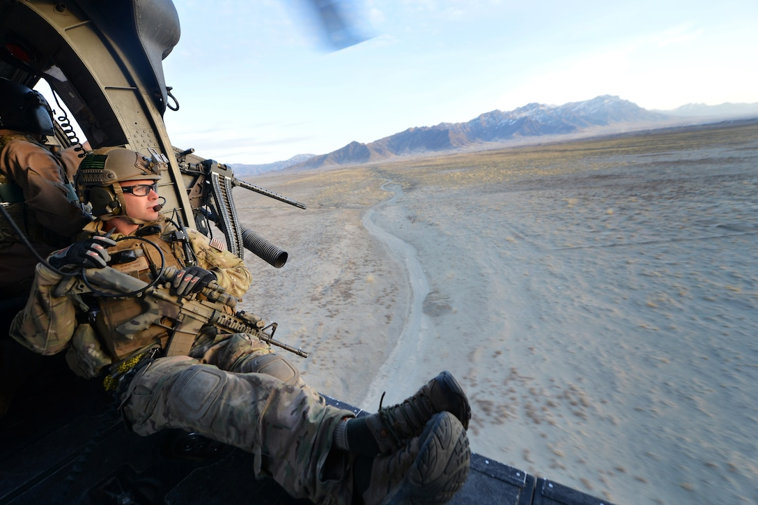 Staff Sgt. George Reed, 83rd Expeditionary Rescue Squadron pararescueman, watches the terrain during a training mission outside of Bagram Airfield, Afghanistan, March 12, 2013. The 83rd ERQS Guardian Angel are comprised of three career fields: the CRO (combat rescue officer), the PJ (pararescuemen) and SERE (survival, evasion, resistance, escape).  (U.S. Air Force photo/Senior Airman Chris Willis)