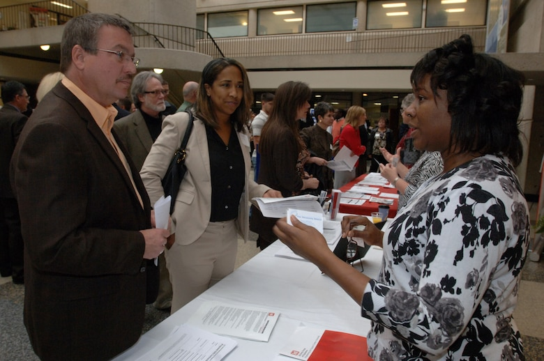 Nicole C. Boone (Right), U.S. Army Corps of Engineers Huntsville Engineering and Support Center, interacts with business owners and managers at the Tennessee Small Business Center on the Avon Williams Campus at Tennessee State University in Nashville, Tenn., during the Small Business Training Forum March 13, 2013. (USACE photo by Leon Roberts)