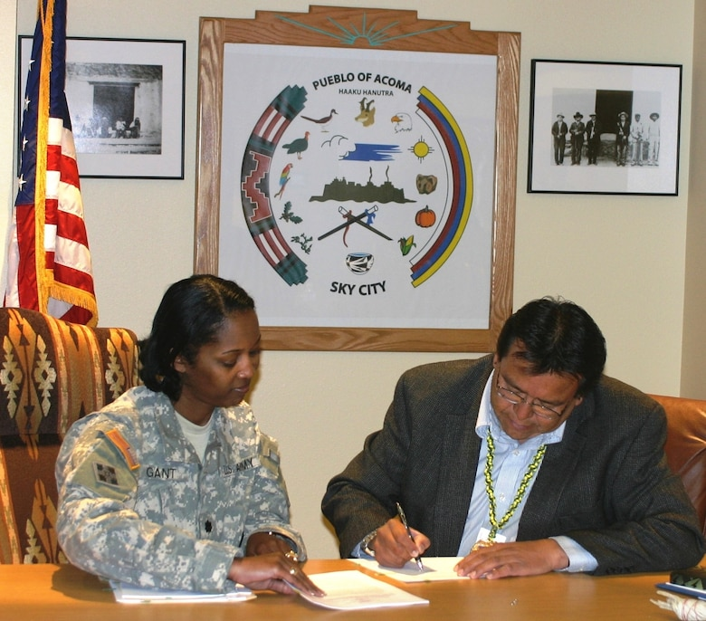 ACOMA PUEBLO, N.M., -- Albuquerque District Commander Lt. Col. Antoinette R. Gant watches as Acoma Pueblo Gov. Gregg P. Shutiva signs a Watershed Cost Share Agreement with the District March 6, 2013. The agreement is only the second such agreement across the Corps under the Section 203 Tribal Partnership Program.