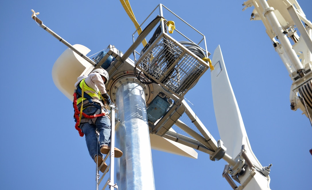 A contractor makes adjustments to a wind turbine 120 feet above Buckhorn Recreation Area at Black Butte Lake, a U.S. Army Corps of Engineers Sacramento District park, near Orland, Calif. The turbine can generate 11 kilowatts of energy to help supply the needs of campers at Black Butte Lake.