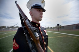 Lance Cpl. Garrett A. Troutner is a rifleman, assigned to the Marine Corps' Silent Drill Platoon, who performed in the 2013 Battle Color Ceremony held on the Paige Filedhouse Football Field here March 15. In addition to the countless hours these Marines spending perfecting their drill sequence, they also make time to maintain their Marine rifleman skills with field training exercises.