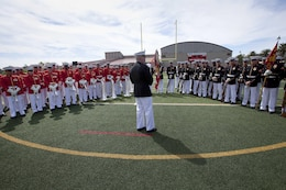 Lt. Gen. John A. Toolan, center, thanks the Marines from the Battle Color Detachment for their performance after the Battle Color Ceremony at the Paige Fieldhouse Football Field here March 15. Toolan is the commanding general for the 1st Marine Expeditionary Force here.