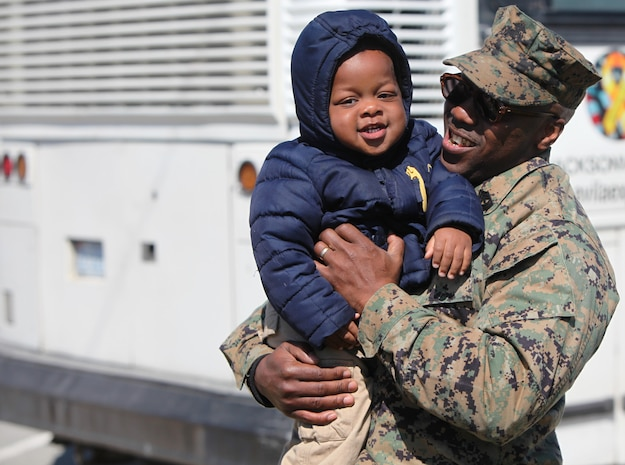 Marines and sailors with Black Sea Rotational Force 13 deployed from Marine Corps Base Camp Lejeune, N.C., to Eastern Europe today for a six-month tour. First Sgt. Charles McDew holds his grandson one more time before getting on the bus.