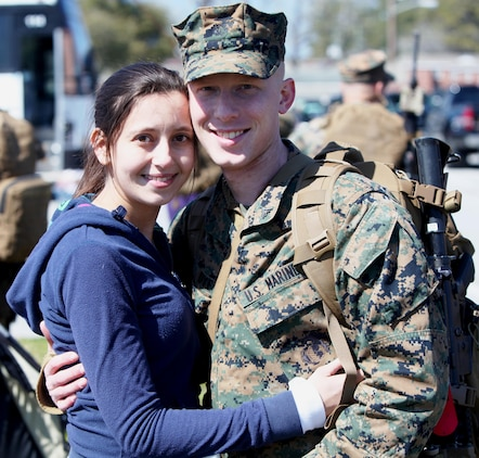 Marines and sailors with Black Sea Rotational Force 13 deployed from Marine Corps Base Camp Lejeune, N.C., to Eastern Europe today for a six-month tour. Lance Cpl. Michael Dye and his wife embrace one more time before getting on the bus to depart.