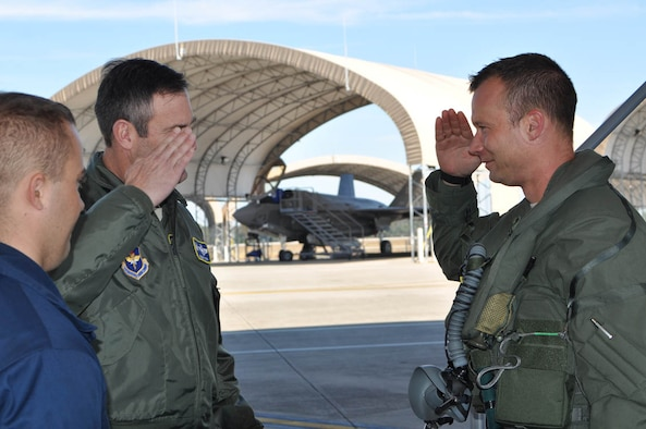 EGLIN AIR FORCE BASE, Fla. -- (Far right) Maj. Joseph Scholtz, 706th Fighter Squadron operational test pilot, salutes Col. Andrew Toth, 33rd Fighter Wing commander, upon completion of his first training sortie in the F-35 II Lightning here Oct. 30, 2012. Scholtz is a reservist assigned to Nellis Air Force Base, Nev., as the installation's first qualified F-35 pilot. (photo courtesy of 53rd Wing public affairs)