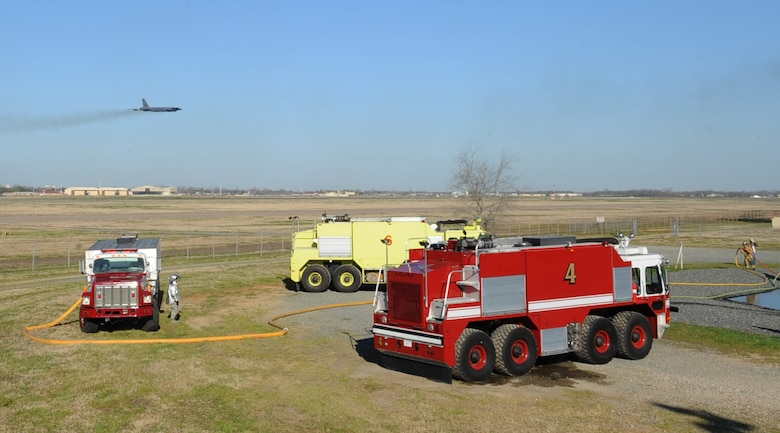 Firefighters from the 2nd Civil Engineer Squadron standby during a joint training exercise on Barksdale Air Force Base, La., March 15. The Shreveport Fire Department teamed up with Airmen from the 2 CES fire department to conduct their annual aircraft training. (U.S. Air Force photo/Senior Airman Sean Martin)