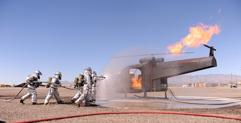 U.S. Air Force Airmen from the 355th Civil Engineer Squadron fire department extinguish a fire as part of their training during the operational readiness exercise on Davis-Monthan Air Force Base, Ariz., March 13, 2013. Airmen from across the 355th Fighter Wing simulated many scenarios that consisted of self-aid and buddy care, and chemical, biological, radioactive nuclear explosive responses.  (U.S. Air Force photo by Airman 1st Class Christine Griffiths/Released)