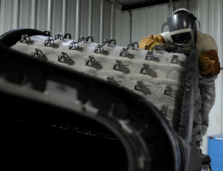 WHITEMAN AIR FORCE BASE, Mo. – U.S. Air Force Tech. Sgt. Jim Gargano, 509th Maintenance Squadron metals technology assistant section chief, welds a connector of a B-2 Spirit Bomber tail pipe liner, Mar. 6. Technicians make use of a wide variety of equipment, including welders, grinders, mills and lathes.  (U.S. Air Force photo/Staff Sgt. Alexandra M. Boutte) (RELEASED)