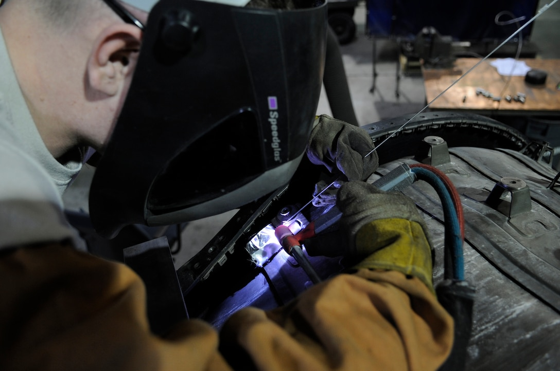 WHITEMAN AIR FORCE BASE, Mo. – U.S. Air Force Tech. Sgt. Jim Gargano, 509th Maintenance Squadron metals technology assistant section chief, welds a connector of a B-2 Spirit Bomber tail pipe liner, Mar. 6. The equipment technicians use includes welders, grinders, mills and lathes.  (U.S. Air Force photo/Staff Sgt. Alexandra M. Boutte) (RELEASED)