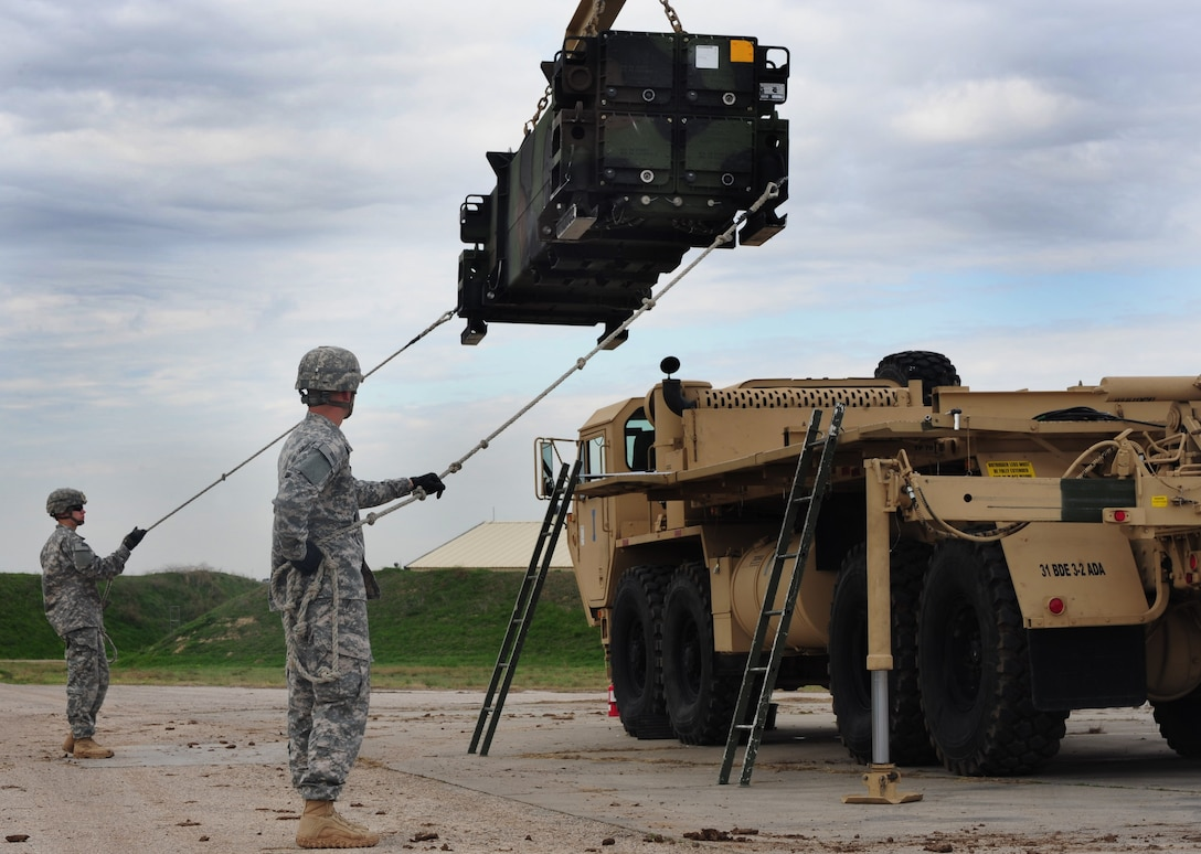 Soldiers from the 3rd Battalion, 2nd Air Defense Artillery unit, Fort Sill, Okla., raise a Patriot missile battery before loading it onto a transport Jan. 30, 2013 at Incirlik Air Base, Turkey. The Patriot missile batteries have increased the work load and responsibilities of numerous squadrons at Incirlik. Squadrons such as security forces, contracting and maintenance have aided in the continued success of the Patriot mission, thus increasing the safety and security of the region. (U.S. Air Force photo by Senior Airman Anthony Sanchelli/Released)
