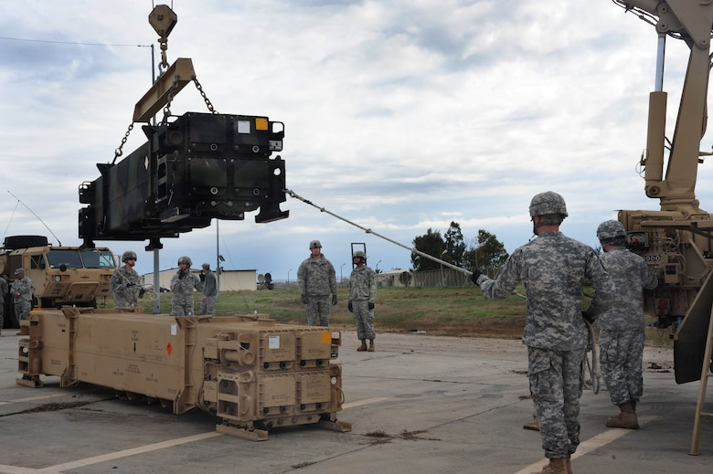 Soldiers from the 3rd Battalion, 2nd Air Defense Artillery unit, Fort Sill, Okla., raise a Patriot missile battery before loading it onto a transport Jan. 30, 2013 at Incirlik Air Base, Turkey. U.S. Army, German and Dutch forces have become an intricate part of Incirlik after the arrival of the Patriots. With the Patriot mission here, many units of the 39th Air Base Wing have increased their work load to assist in the success of the new mission. (U.S. Air Force photo by Senior Airman Anthony Sanchelli/Released)