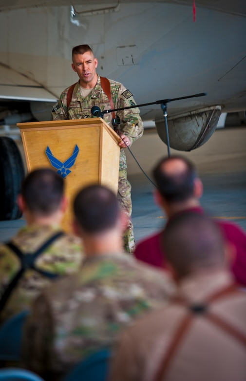"""Col. Brook Leonard, 451st Expeditionary Operations Group commander, speaks during an activation ceremony for the 430th Expeditionary Electronic Combat Squadron at Kandahar Airfield, March 13, 2013. The unit, which flies the E-11A, was previously designated as the 451st Tactical Airborne Gateway. """"It's really neat that we can do this given the context of this day and age,"""" Leonard said. """"Right now we're on the precipice of drawdown and redeployment operations, so to stand up a squadron in this kind of environment is really a privilege. In many ways it speaks to the quality and excellence this unit has exhibited while they were the TAG."""" (U.S. Air Force photo/Senior Airman Scott Saldukas)"""