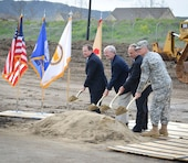 """(From left) Mr. Addison """"Tad"""" Davis, Mr. Don Biddle, Mr. Joe Guerra, and Lt. Col. (P) David James break ground during a ceremony March 6, 2013 commemorating the first of six phases of construction at U.S. Army Garrison Camp Parks Reserve Training center in Dublin, Calif. The U.S. Army Corps of Engineers Sacramento District's real estate office is overseeing a 180-acre transfer of land in exchange for an estimated $66 million in modern facilities for Camp Parks over the next several years""""the largest Army Reserve real property exchange agreement in Department of Defense history."""