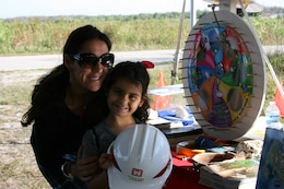 "Everglades Day at the Arthur R. Marshall Loxahatchee National Wildlife Refuge brings many families and children like Sara Green to the Corps booth, where they spin the ""Wayne Drop"" wheel and learn about the Everglades and water safety."