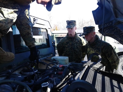 Sgt Purington instructing PFC Meade and PFC Metts on proper PMCS of a HMMWV (M1165) at the 58th Trans Motor Pool, Ft. Leonard Wood, Mo. during MVOC training.