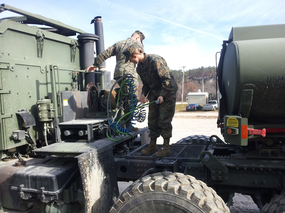 Lance Corporal Melissa L. Mueller from MWSS 271 and Lance Corporal Ryan T. Mann from CLR-2 perform Coupling and Uncoupling practical application of an AMK31 and MK970 on November 15, 2012 at Ft. Leonard Wood, MO while attending Semi-Refueler Operators Course 1-13. This is one of the first events students learn in the course prior to learning and performing tractor trailer operations and refueling operations.
