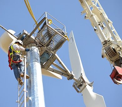 A contractor makes adjustments to the wind turbine 120 feet above Buckhorn Recreation Area at Black Butte Lake. Installation of the turbine took place March 13, 2013. Expected to go online within 30 days, the turbine will help supply the needs of campers.