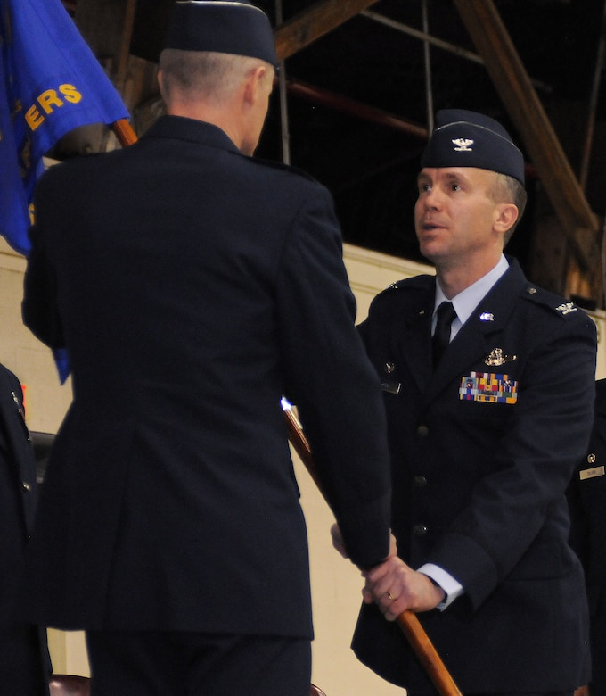 Colonel Jeremy Baenen, incomming commander for the 173rd Fighter Wing, accepts the Wing guideon from Brig. General Steven Gregg, Commander Oregon Air National Guard, during an official change of command ceremony January 13, 2013 at Kingsley Field.  (U.S. Air Force photo by Master Sgt. Jennifer Shirar) RELEASED