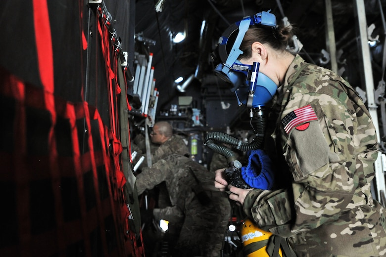 Capt. Rachel Hutchins, 455th Expeditionary Aeromedical Evacuation Squadron flight nurse, conducts checks on the emergency oxygen system on a C-130 Hercules on Bagram Airfield, Afghanistan, Feb. 21, 2013. The level of care that patients receive in the air is nearly identical to the care they receive at Craig Joint Theater Hospital on BAF. (U.S. Air Force photo/Senior Airman Chris Willis)
