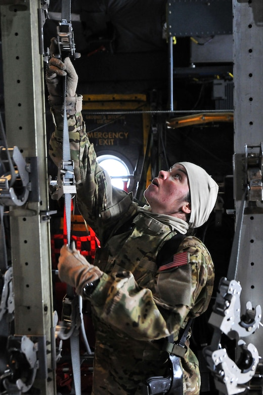 Master Sgt.  Jennifer Higgs, 455th Expeditionary Aeromedical Evacuation Squadron technician, conducts an equipment function check inside a C-130 Hercules on Bagram Airfield, Afghanistan, Feb. 21, 2013.  The 455th EAES perform their missions on fixed wing aircraft, including the C-17 Globemaster III, C-130 Hercules and KC-135 Stratotanker, and can provide extensive critical care capability with the Critical Care Air Transport Teams. (U.S. Air Force photo/Senior Airman Chris Willis)