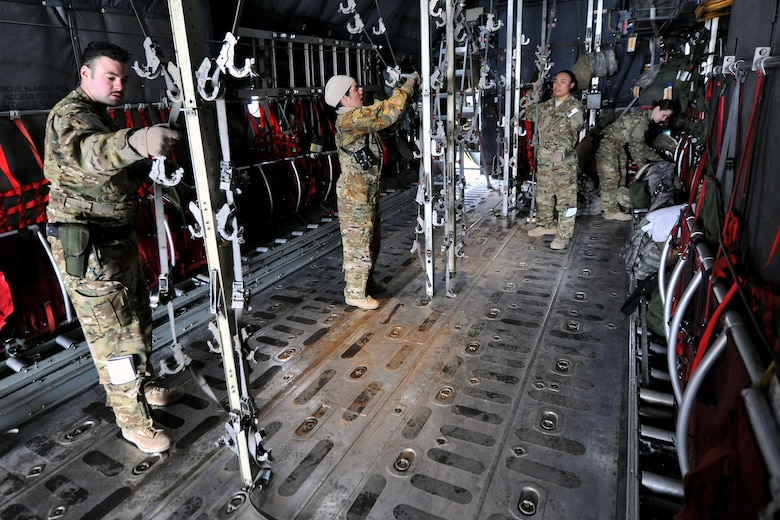 Members of the 455th Expeditionary Aeromedical Evacuation Squadron finish configuring a C-130 Hercules on Bagram Airfield, Afghanistan, Feb. 21, 2013. The 455th EAES provides medical and nursing care in flight to ill or injured servicemembers or Department of Defense civilians.  (U.S. Air Force photo/Senior Airman Chris Willis)