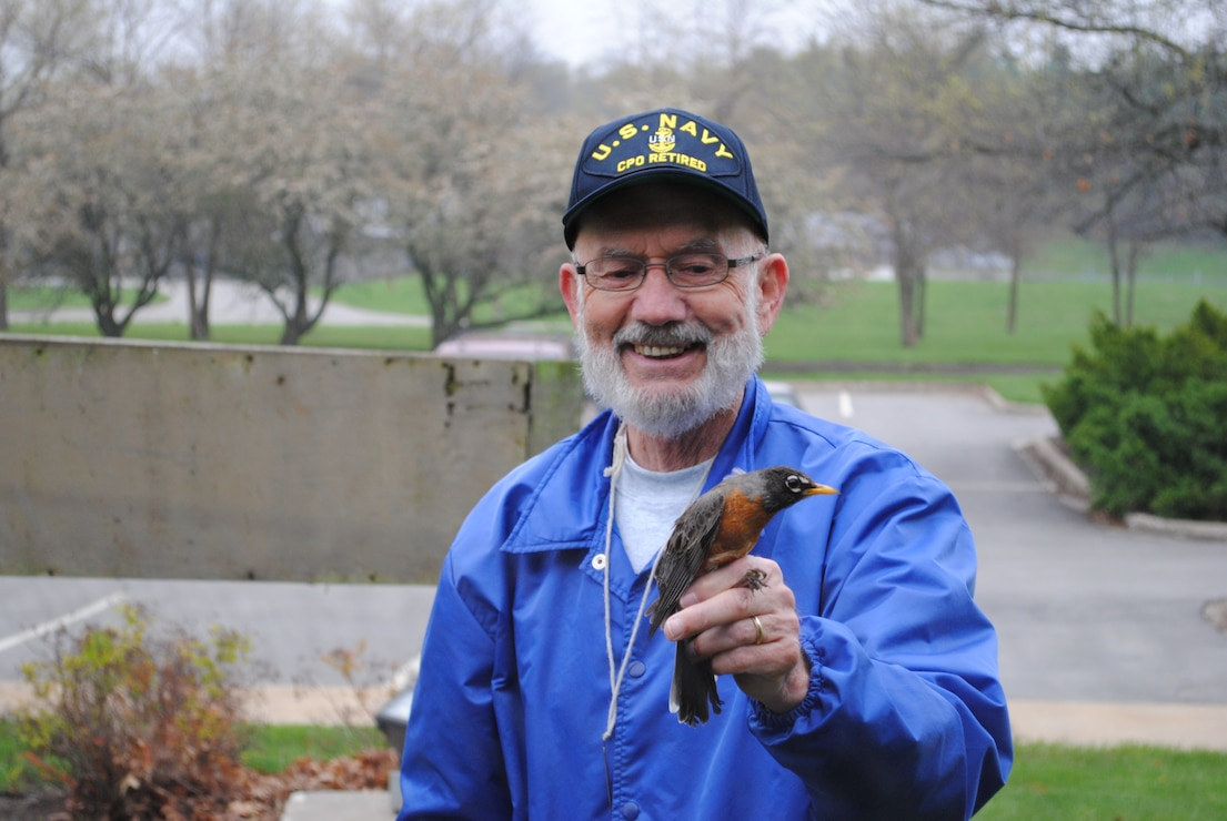 Licensed Bird Bander Nelson Hoskins with American Robin