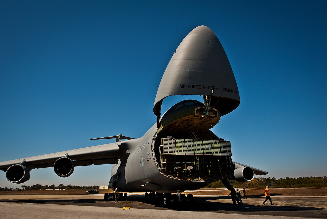The nose of a C-5 Galaxy, from the 433rd Airlift Wing, lifts up so aircrew and 96th Test Wing air transportation Airmen can begin off-loading equipment at Eglin Air Force Base, Fla., March 14.  The reserve wing's aircraft brought maintenance equipment from the 482nd Fighter Wing to the base in preparation for the weapons system evaluation program taking place March 18-22.  (U.S. Air Force photo/Samuel King Jr.)